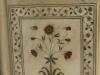 Цветок на плитке